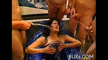 Boy-friends pissing wildly on babe