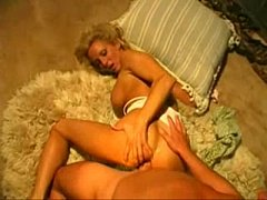Blonde MILF TJ H. By The Fireplace