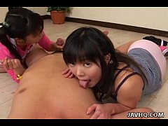 Two cute innoncent Japanese teens playing with ...