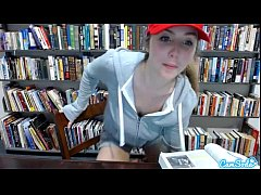 teen latina in public library showing off her h...