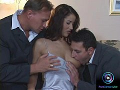 Angel Dark sucking and fucking two dicks at the...