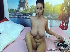 Big titted brunette teasing on webcam
