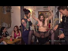Rope tied babe disgraced in public bar