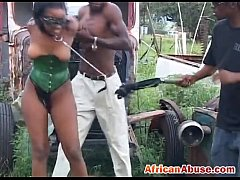 Enchained African babe gets abused by two horny...