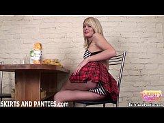 Blonde schoolgirl Sascha flashing her striped panties