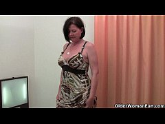 Curvy mature mom in stockings toying hair ...