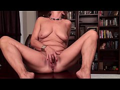 Mature mom playing with her shaved vagina on ca...