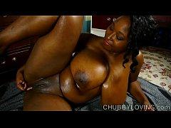 Beautiful busty black BBW oils up her amazing b...