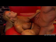 Busty blonde gets her sausage portion on a red ...