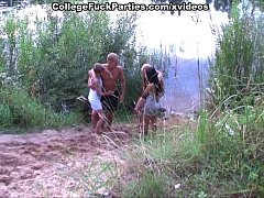 Two student couples heavily pair off on the riv...