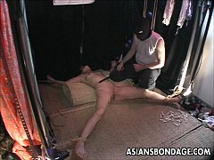 Bound Asian slave gets a full bdsm treatment.