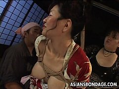 Bound Japanese MILF groans while her pussy is t...