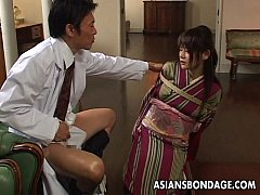 Asian lass is sucking on the dick tied up