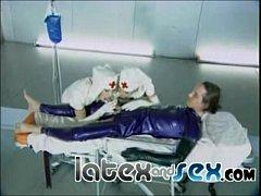 Latex nurses treat a rubber gas mask guy