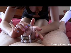 Locked up in a chastity device by two bitches