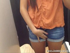 Self-filmed pussy play in public changing room