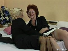 Granny fucks her lesbian friend's pussy with st...