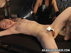 Asian babes hold the slut down so she gets puss...