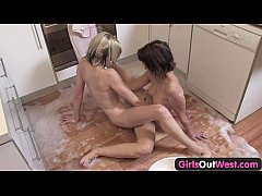 Girls Out West - Soapy lesbian babes use fingers in the kitchen