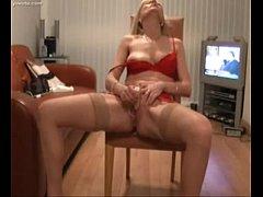 Blonde milf cumming after stripping her red lin...