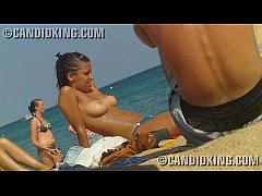 Sexy young teen topless on the beach showing he...