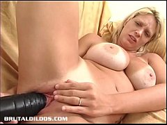 Busty blonde punishes her pink pussy with thick...