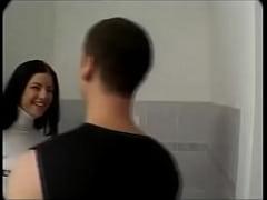 Brunette Sucking Cock in a Public Bathroom