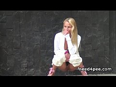 Blonde in leather jacket takes a pee standing