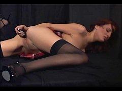 Redhead masturbates in sheer stockings and heels
