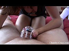 Locked in a chastity device by to cruel bitches