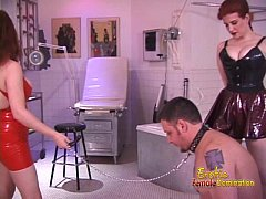 Two stunning redhead dominas and one really hor...