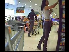 Babe in sexy leather pants at supermarket