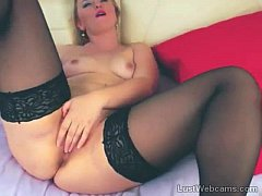 Blonde MILF toys her shaved pussy on cam