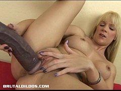 Busty blonde riding a massive brutal dildo
