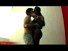 Long haired ebony tranny plays with her big she...