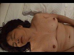 Horny Japanese milf  Kui Somya  toying her puss...