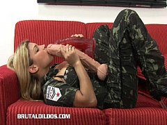 Busty blonde fills her mouth and pussy with massive dildos