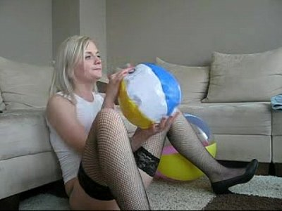 Blonde Fetish Fingering video: Sophie in miniskirt, stockings and red bra playing with beachball