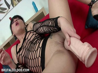 Courtney stretches her wet pussy and mouth with brutal dildos