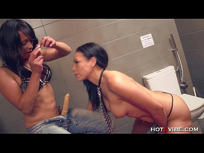 Lesbians Squirting in Public Bathroom with Stra...