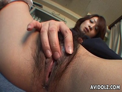 Hairy Asian video: Sweet brunette Asian babe rubs her wet pussy