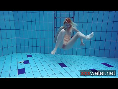 Bikini Blonde Nude video: Milana makes a show in the pool