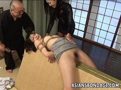Bdsm Bondage Brunette video: Tied up Asian babe gets spanked and dildo fucked
