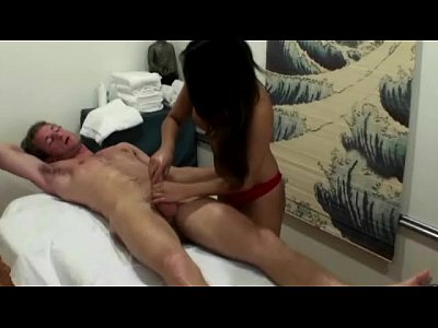 Masseuse asian in panties tugging on cock
