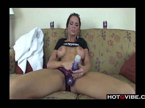 Big boobed brunette uses vibrator for orgasm