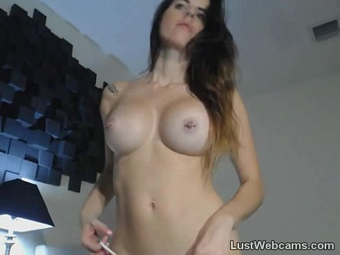 Busty brunette hottie deepthroats dildo on cam