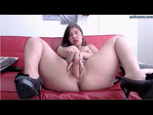 Sexy latina with a big booty spreads legs and fucks herself with a dildo