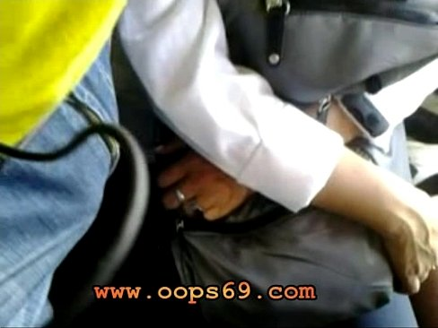 Woman rubber his cock in bus