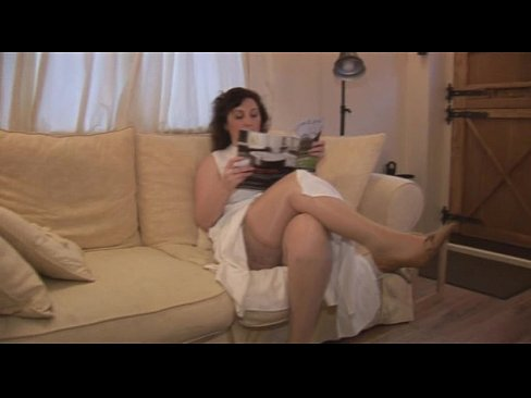 Busty mature horny English lady masturbating on couch