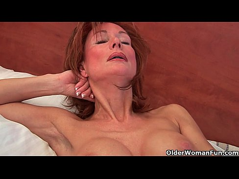 Sultry senior mom probes her old pussy with a large dildo 8